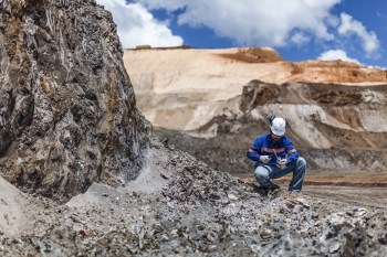 Geologist inspecting samples, Amapa iron ore mine, Brazil