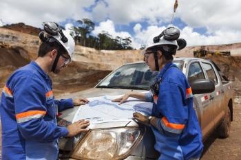 Geologists studying survey plans, Amapa iron ore mine, Brazil