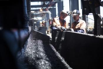 Inspecting coal samples, Dawson colliery, Australia