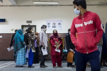 Patients waiting in line for x-rays at the National Institute of Tuberculosis and Respiratory Diseases, New Delhi.
