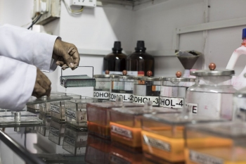 A lab technician preparing slides of tissue samples at the National Institute of Tuberculosis and Respiratory Diseases, New Delhi.
