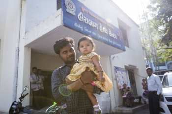 A father and daughter outside the Hirabaug Health Centre, Surat.
