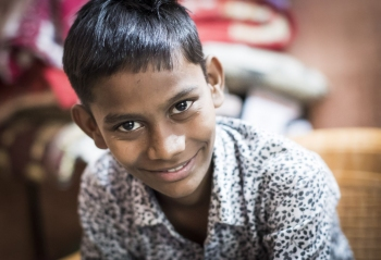 Syed, 14, a TB patient at home in Surat.