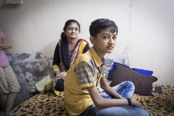Hiren, 14, a TB patient at home with his family in Surat.