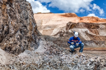 Geologist inspecting samples, Amapa iron ore mine, Brazil, for Anglo American
